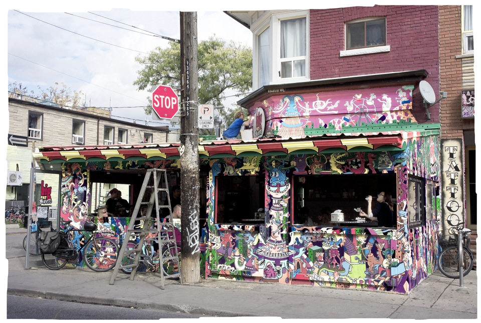 Artist Painting Exterior of the Big Fat Burrito, Kensington Market